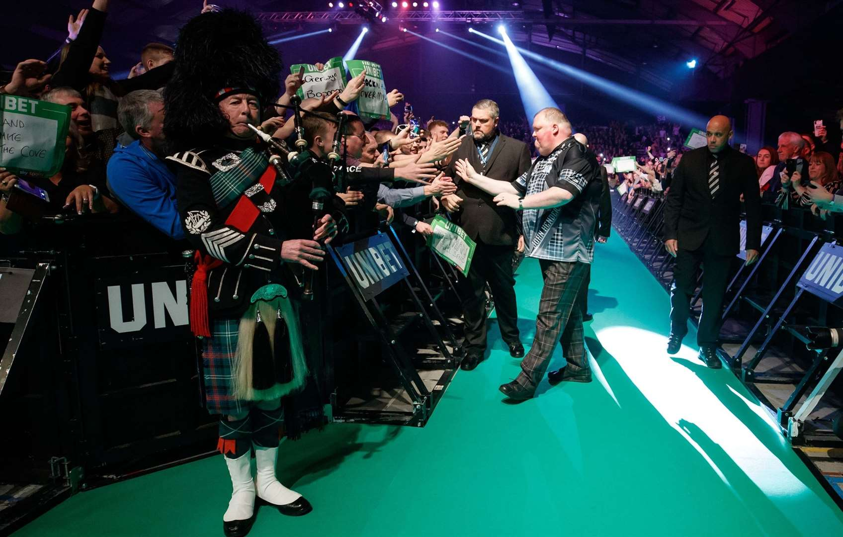 The Highlander is piped in to Flower of Scotland into the Aberdeen arena. Steve Welsh/PDC