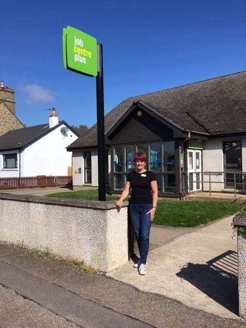It's been a year of change for Jane Munro, pictured here in front of Forres Jobcentre, and her colleagues at DWP.