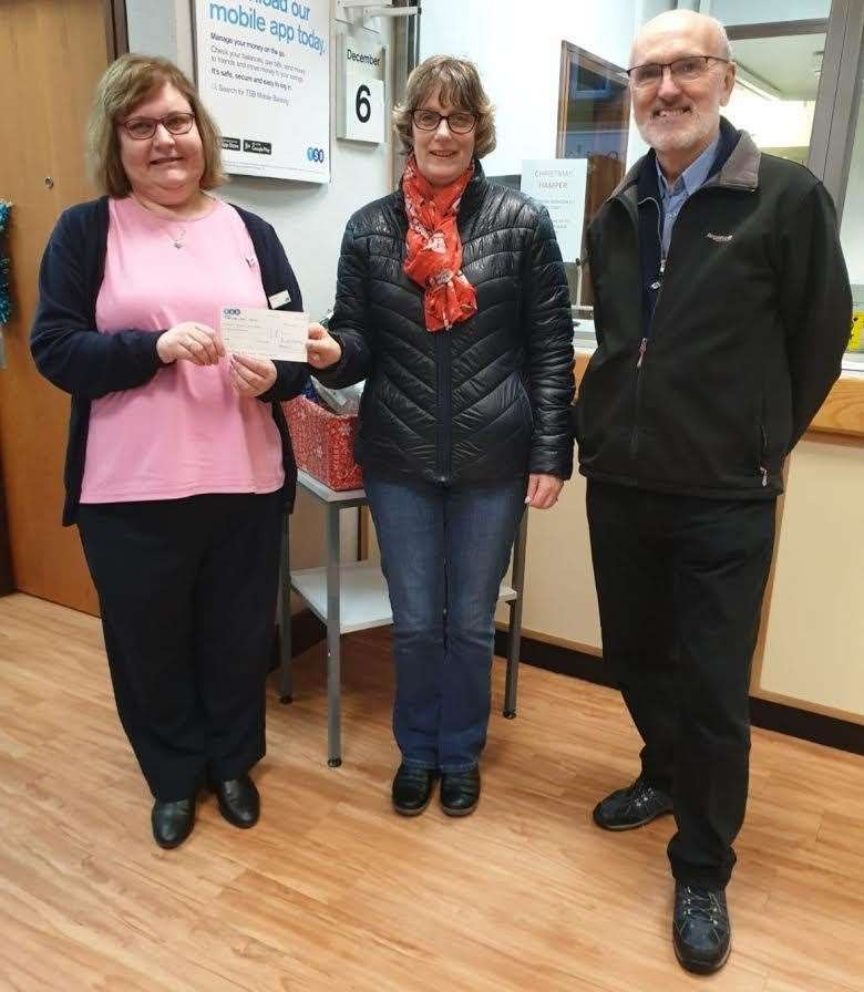 Turriff TSB's Elaine presented committee members Carol Allan and Doug Connon with a donation for the town's Christmas lights.