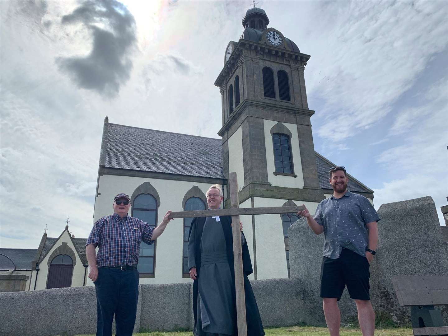Banff minster Rev David Locke (centre) was supported on the penultimate walk of his challenge by Macduff Parish Church minister Rev Hugh O'Brien (left) and Banff River Church pastor Rob McArthur. Picture: Andy Taylor