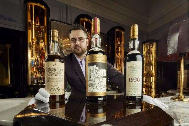 Whisky Auctioneer founder Iain McClune, at The Gleneagles Hotel American Bar, with some of the highlights from Richard Gooding's collection.