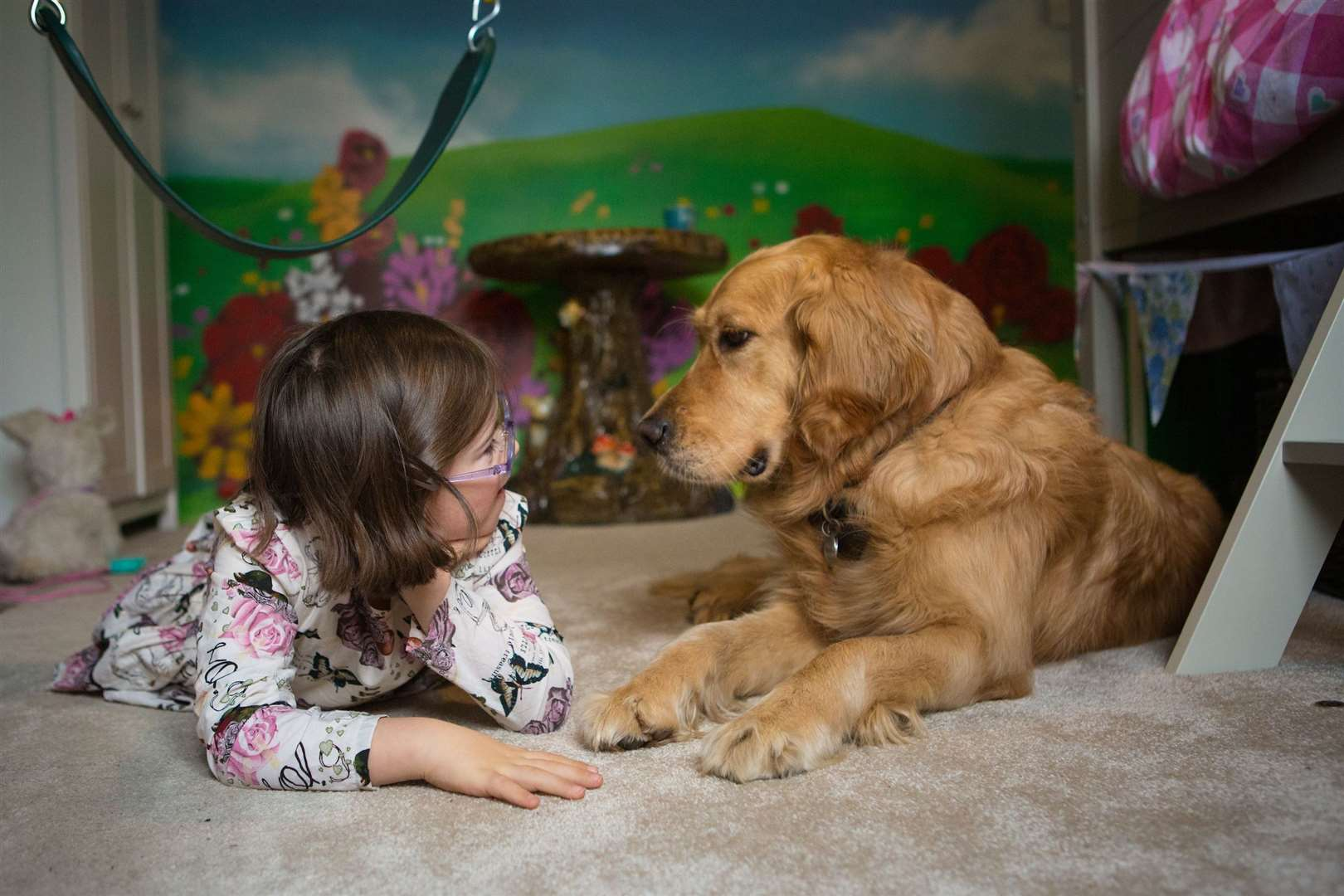 Assistance dog with child. Picture: Dogs for Good.