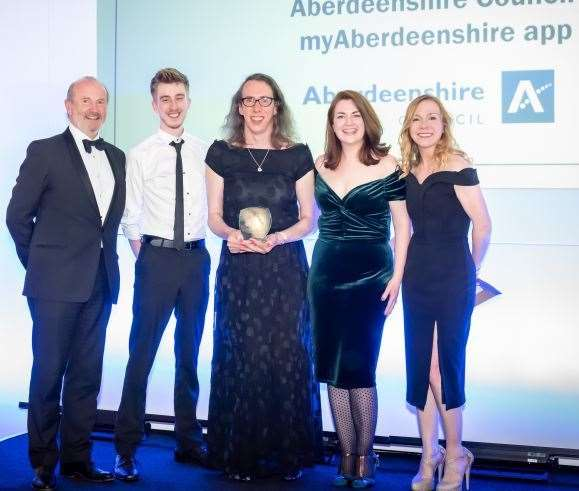 At the Holyrood Connect Awards are (from left): event host Fred Macaulay; Aberdeenshire ICT staff members Dylan Nelson, Heather Herbison and Colleen Henderson; and Carolann Miller chief information officer of Edinburgh City Council who presented the award.
