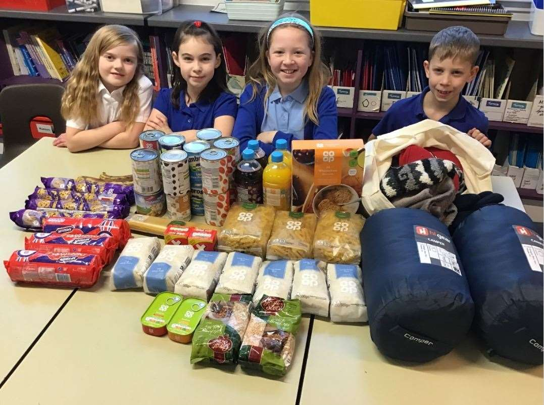 Some of the class show off what they collected to donate to Street Friends Helping The Homeless (Aberdeen).
