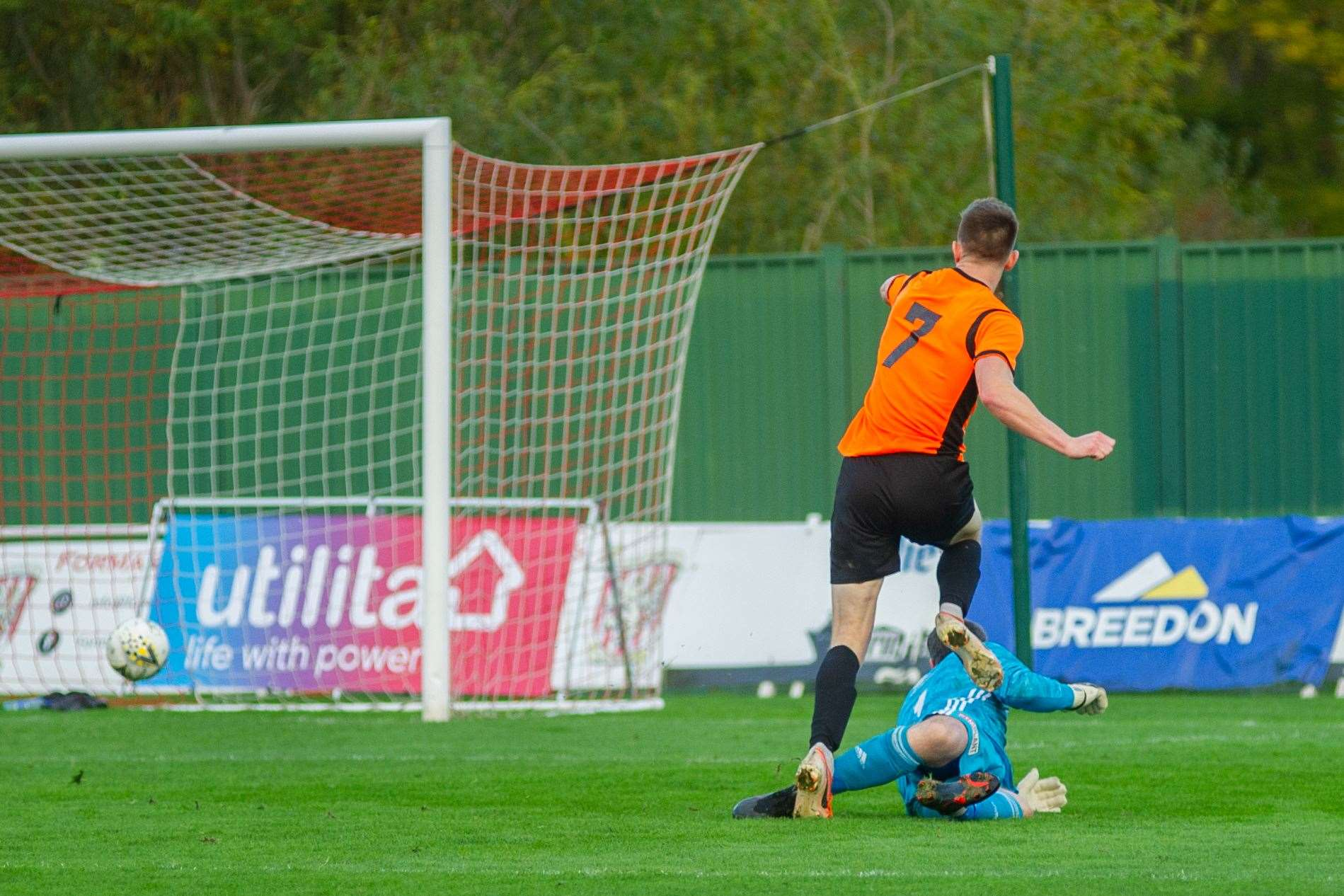 Craig Cormack scores the Rothes winner past Formartine keepr Kevin Main...Picture: Daniel Forsyth..