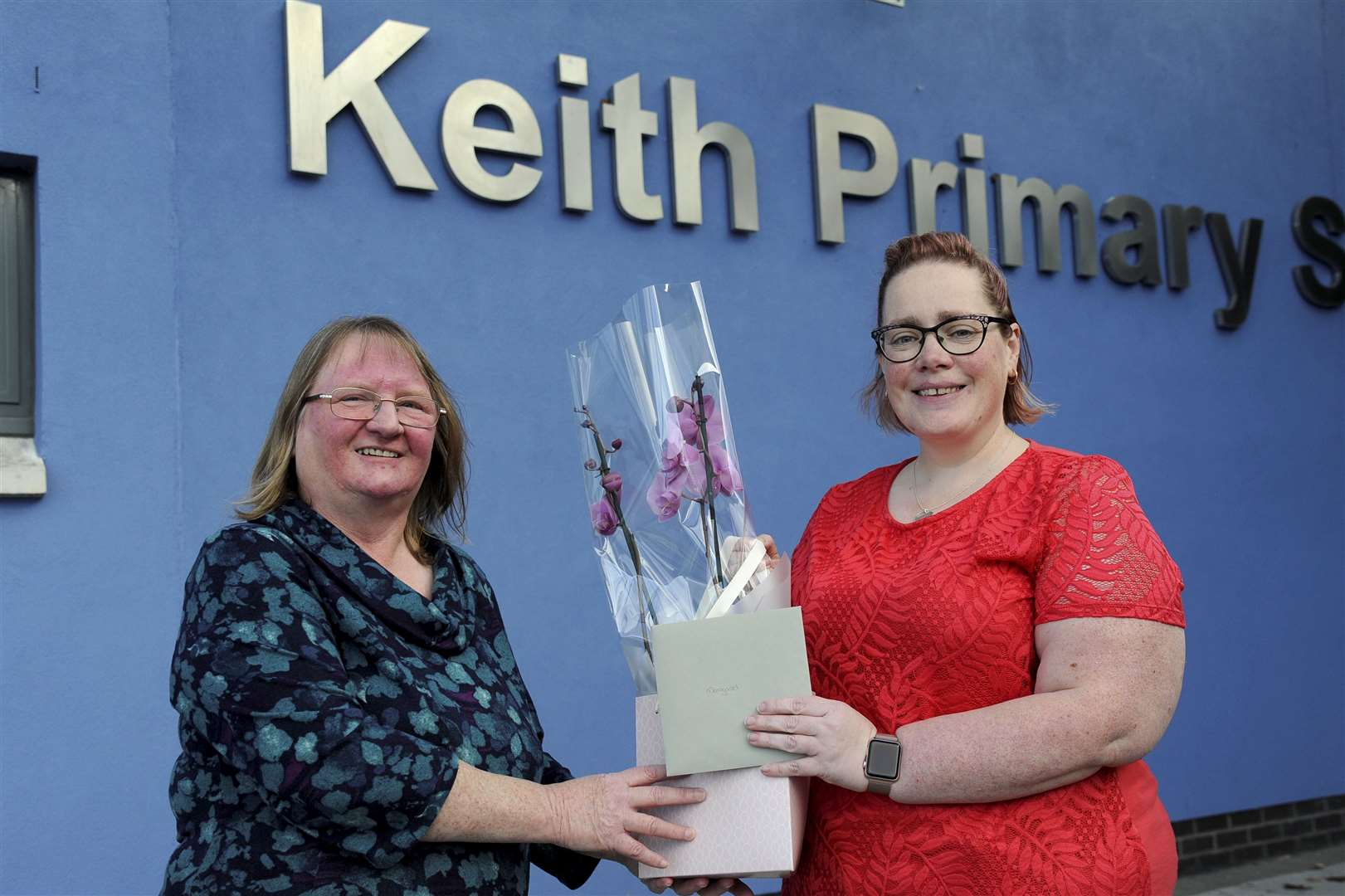 "Admin at Keith Primary School Margaret Gray (left) receives a gift from Gillian Hendry chairman of the ""frog squad"" a PTA and parent council group. Picture: Eric Cormack"